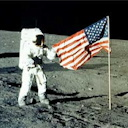Neil Armstrong on the moon with the US flag